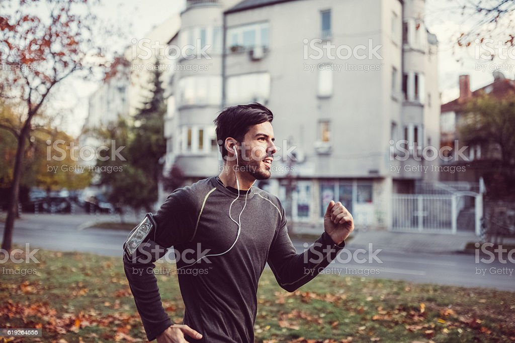 Sportsman jogging stock photo