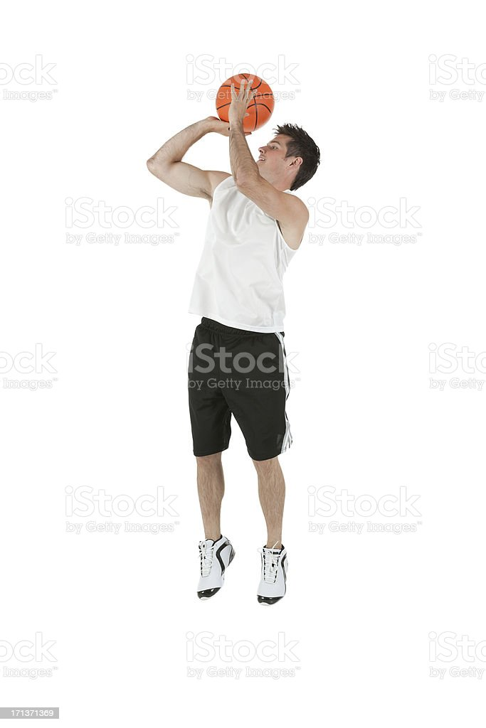 Sportsman jumping with a basketball stock photo