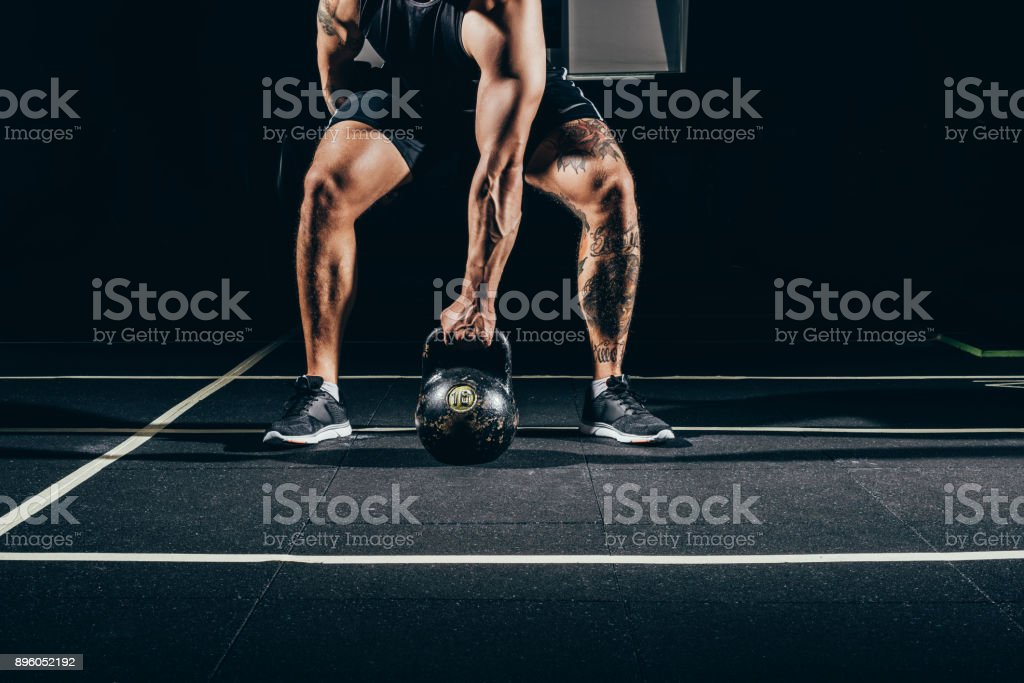 sportsman lifting kettlebell stock photo