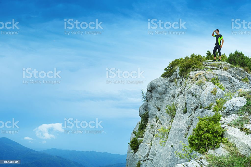 Sportsman looking at view after achievement royalty-free stock photo