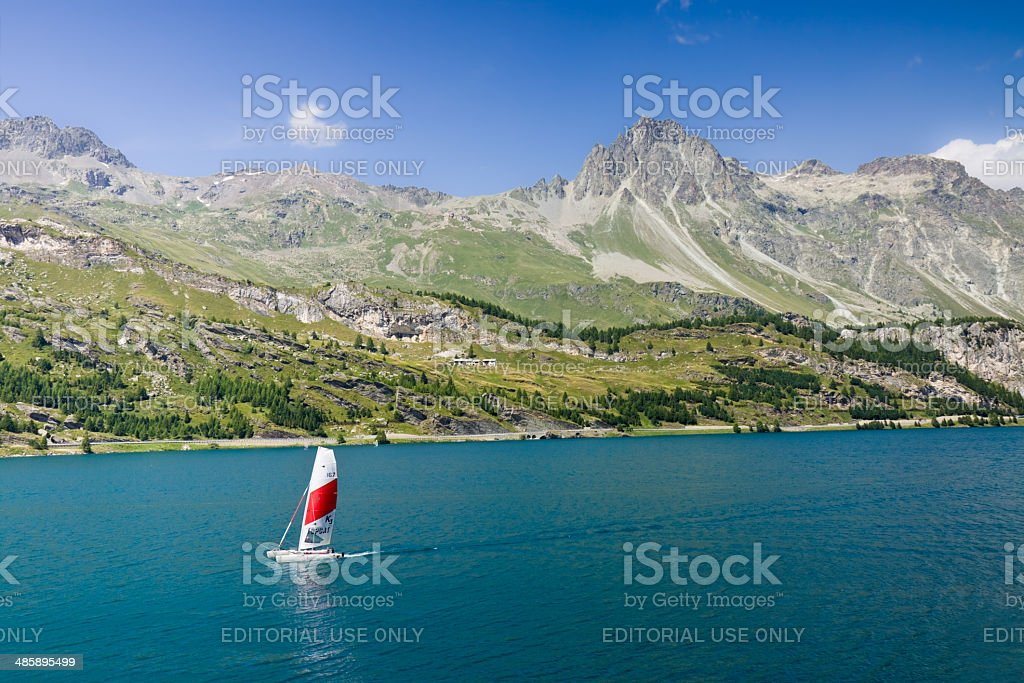 Sportsman on his catamaran in the water of Lake Sils stock photo