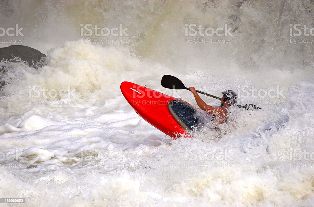 Sportsman on red canoe royalty-free stock photo