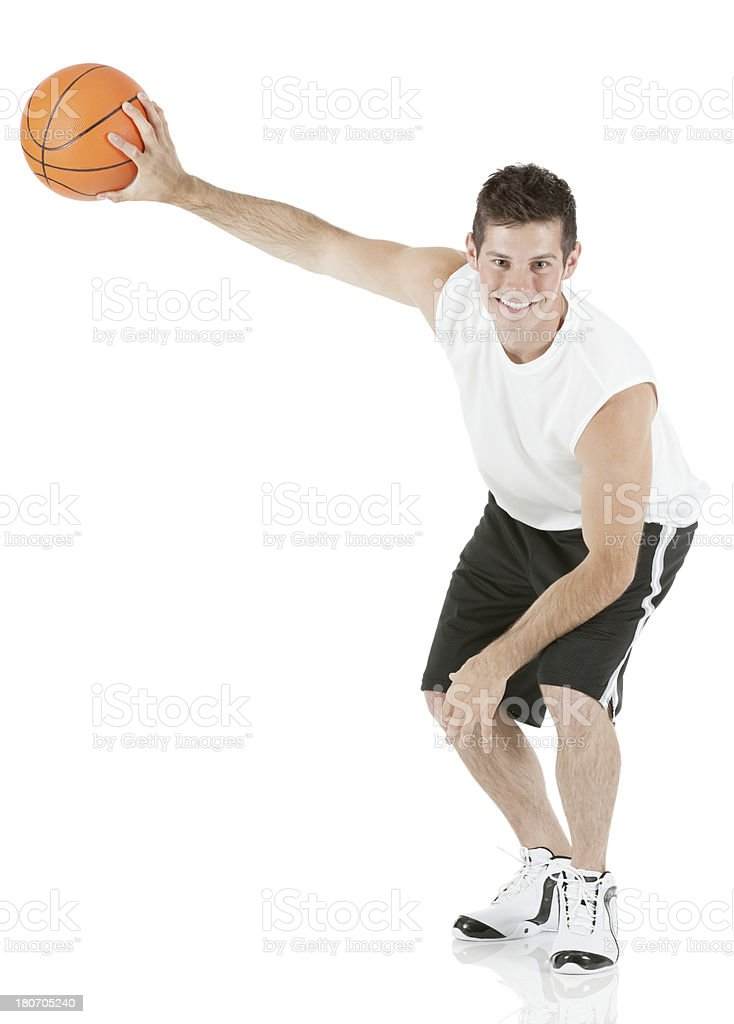 Sportsman playing with a basketball royalty-free stock photo