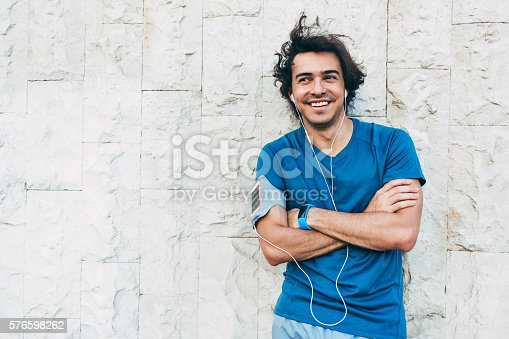 istock Sportsman resting against a stone wall 576598262