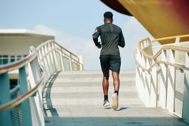 Sportsman running in the street stock photo