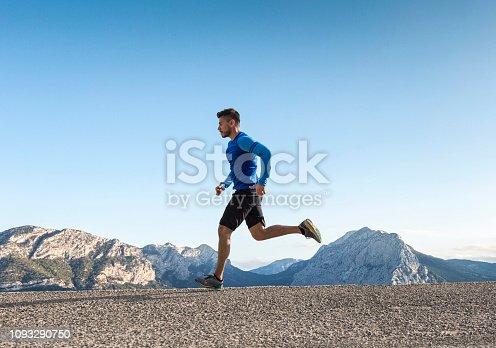 Sportsman running on asphalt road