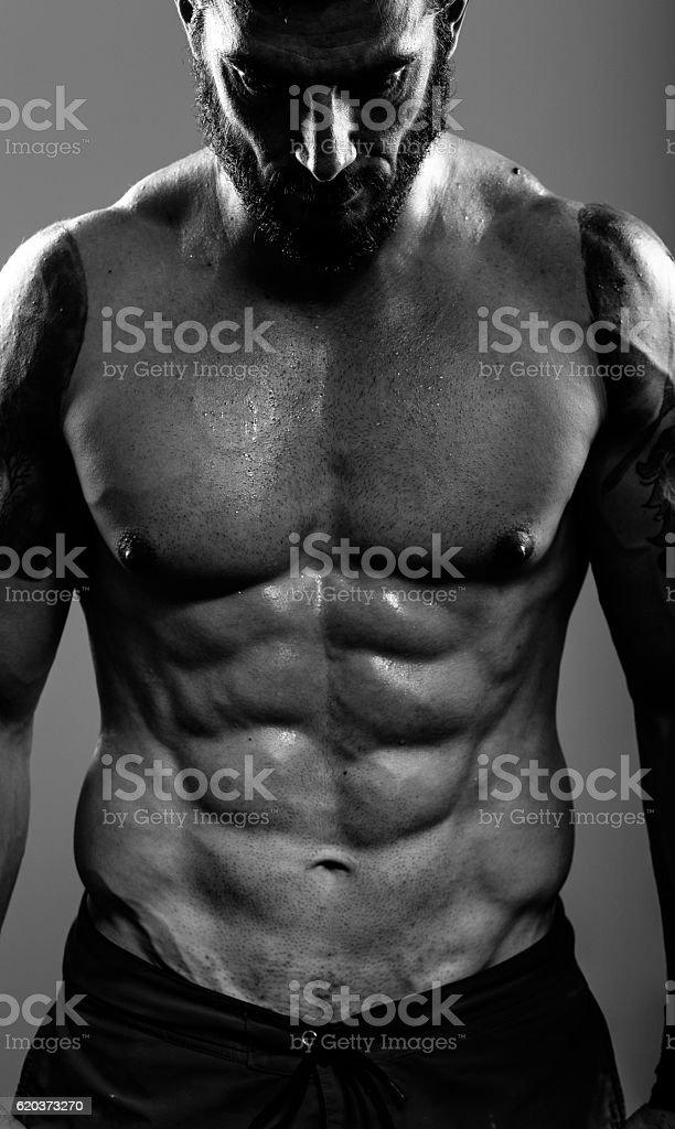 Sportsman with perfect abdominal muscle zbiór zdjęć royalty-free