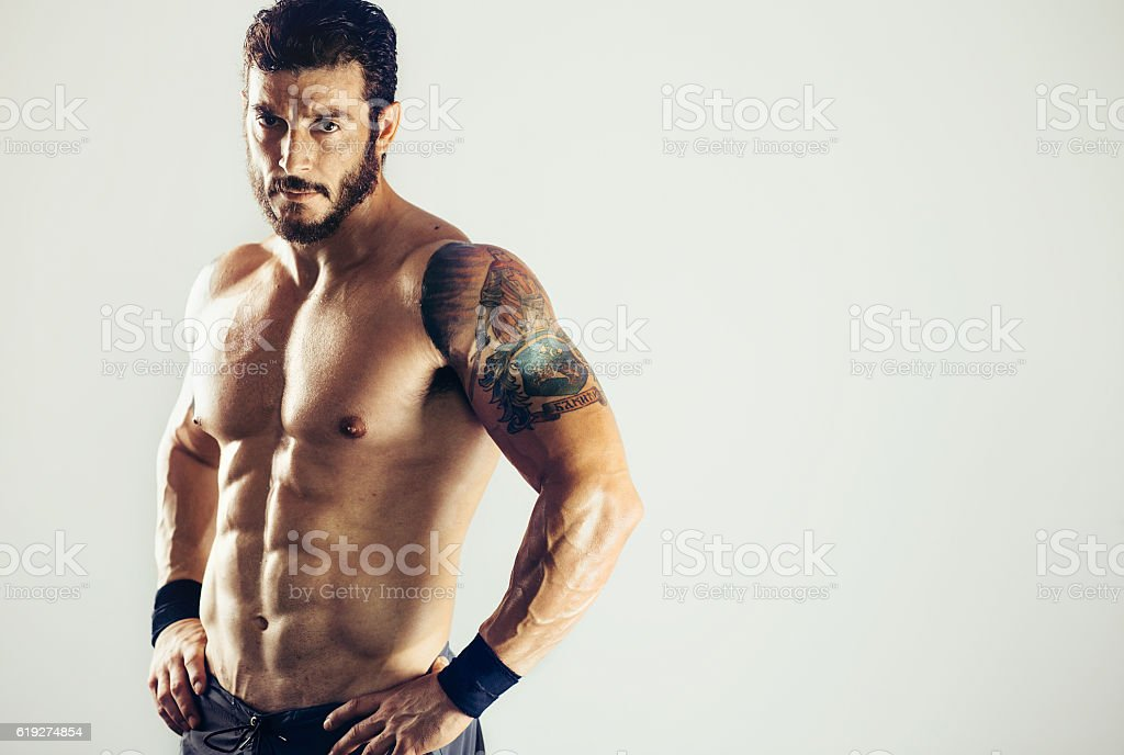 Sportsman with perfect muscle stock photo