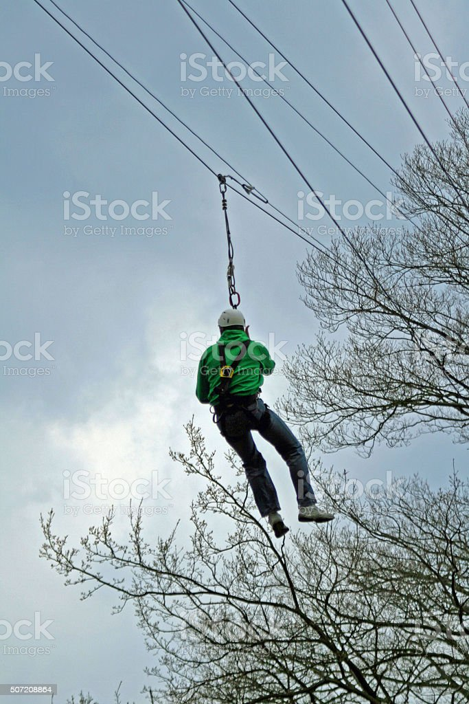 sportsman with zip line stock photo