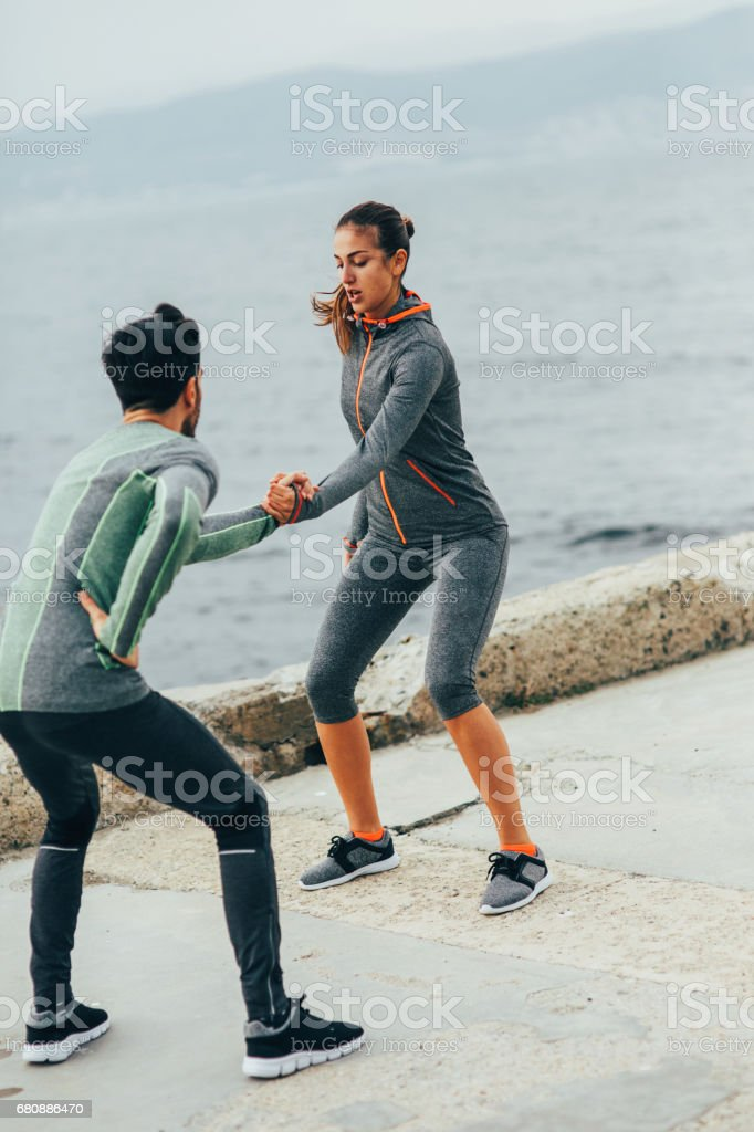 Sportspeople stretching outdoors royalty-free stock photo