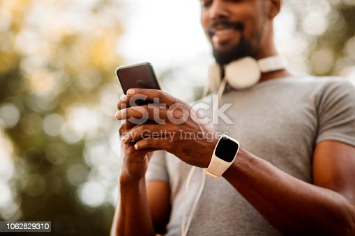 istock Sportsperson texting on mobile phone 1062829310