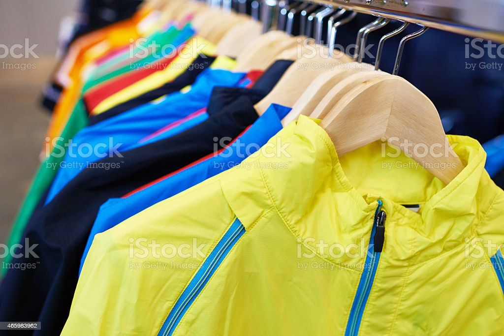 Sportswear on hangers in store stock photo