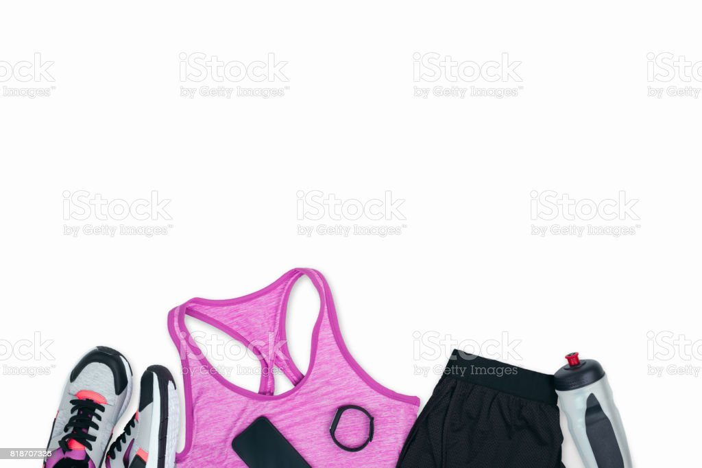 Sportswear with sneakers, smartphone, fitness tracker and sports bottle isolated on white stock photo