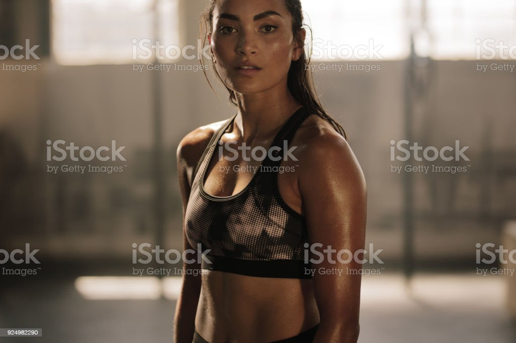 Sportswoman after intense crossing training session stock photo