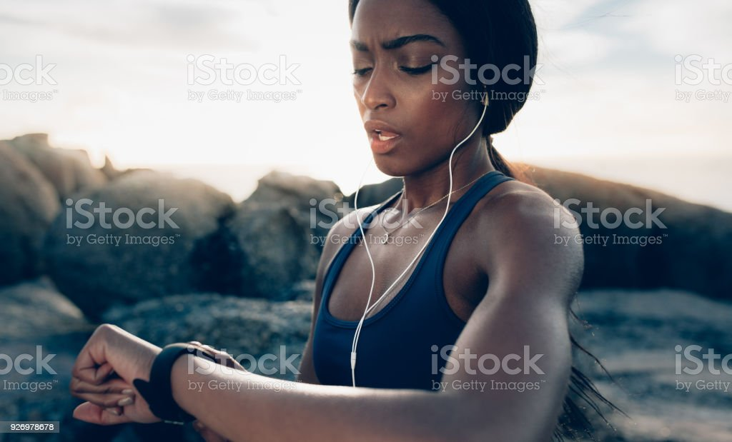 Sportswoman checking fitness progress on her smartwatch stock photo