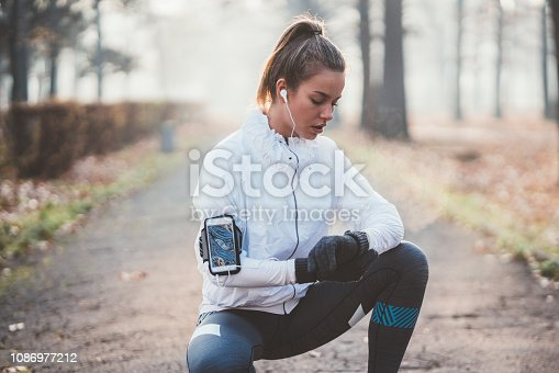 Young woman checking pulse after jogging