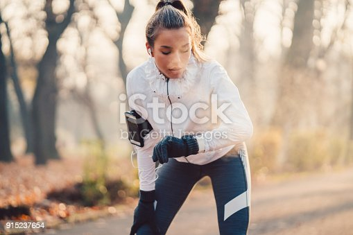 Teenage girl checking heart rate on smartwatch