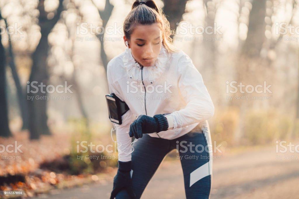 Sportswoman checking pulse stock photo