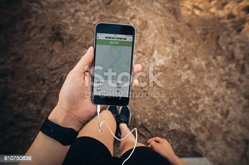 istock Sportswoman checking smartphone after jogging 610750836