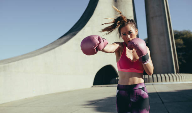 Sportswoman doing boxing working outdoors stock photo