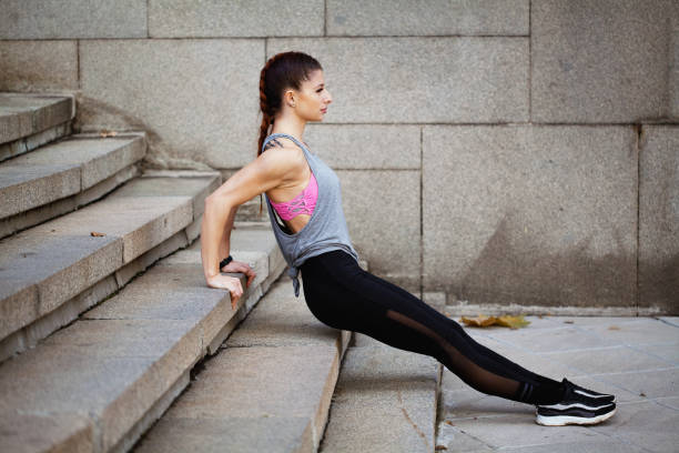 Sportswoman doing dips stock photo