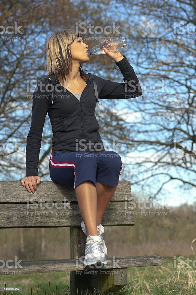 Sportswoman Drinking Water royalty-free stock photo
