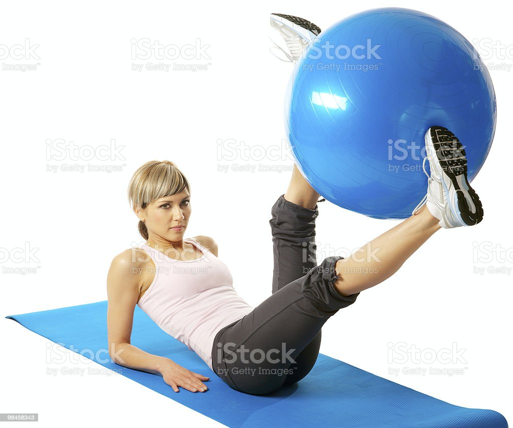 Sportswoman exercising with a Fitness Ball royalty-free stock photo