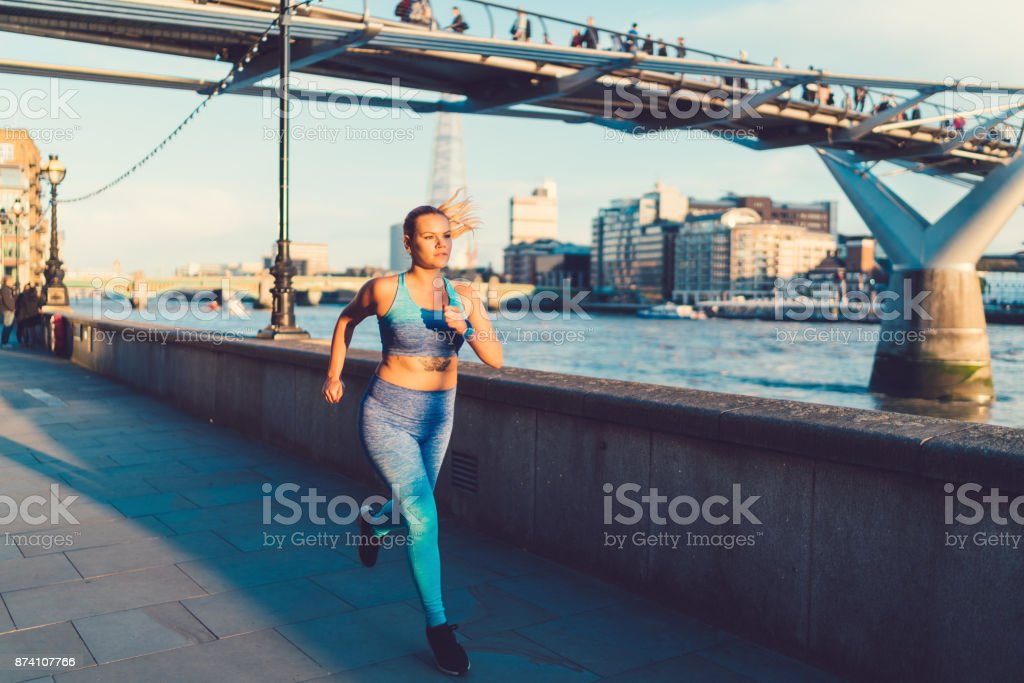 Sportswoman jogging in London stock photo