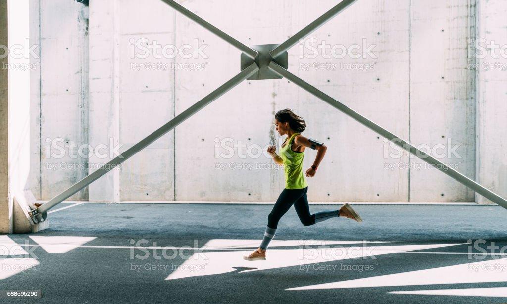 Sportswoman jogging outside stock photo