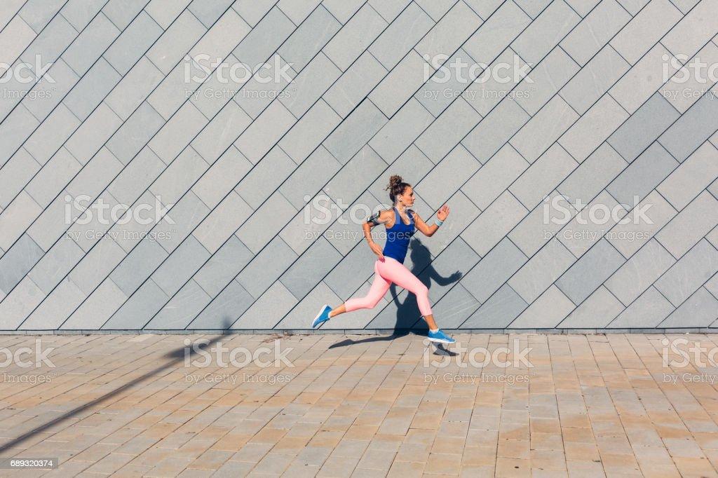 Sportswoman jogging stock photo