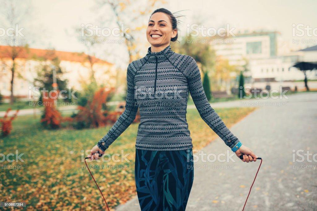 Sportswoman jumping rope stock photo