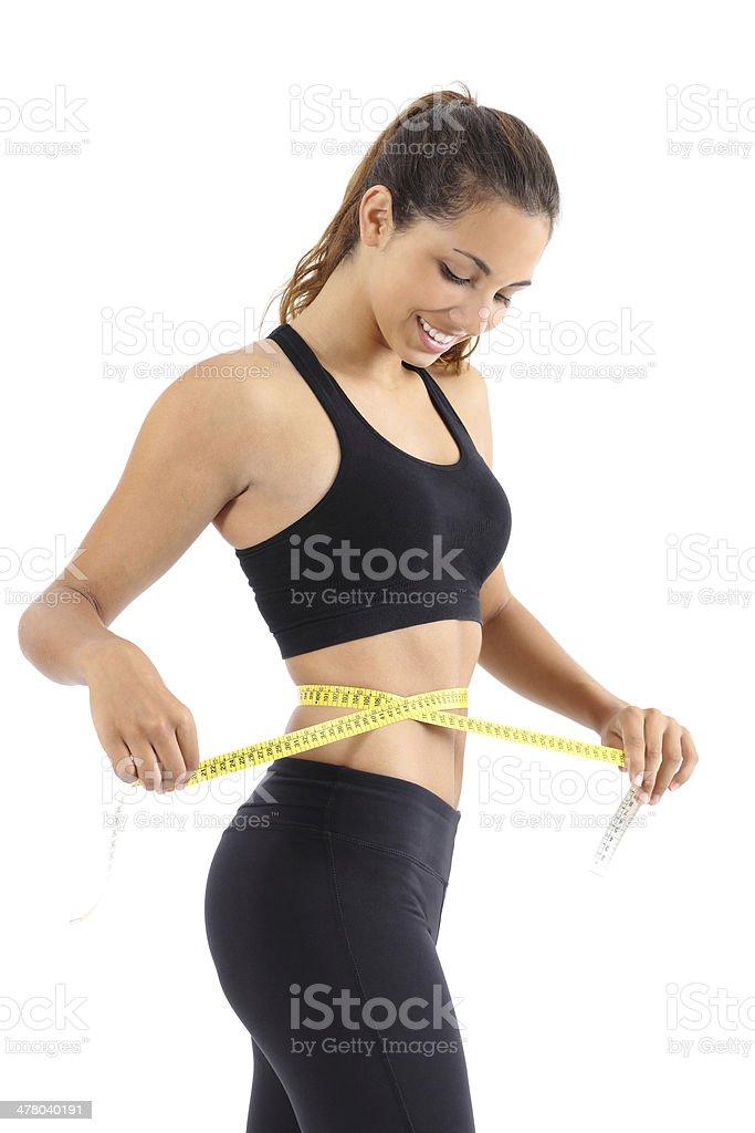 Sportswoman messen Ihre Taille mit der Messung Band – Foto