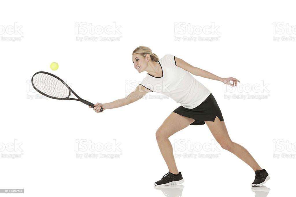 Sportswoman playing tennis stock photo