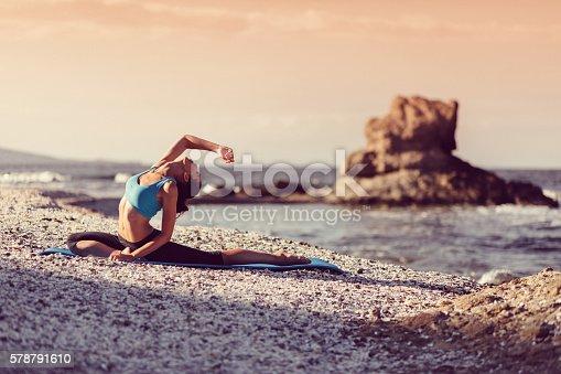 816941230istockphoto Sportswoman practicing yoga 578791610