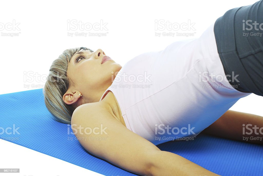 Sportswoman practicing yoga royalty-free stock photo