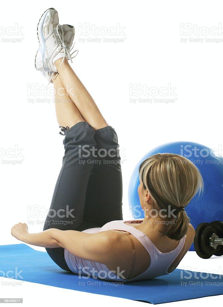 Sportswoman practicing yoga royalty-free stock photo