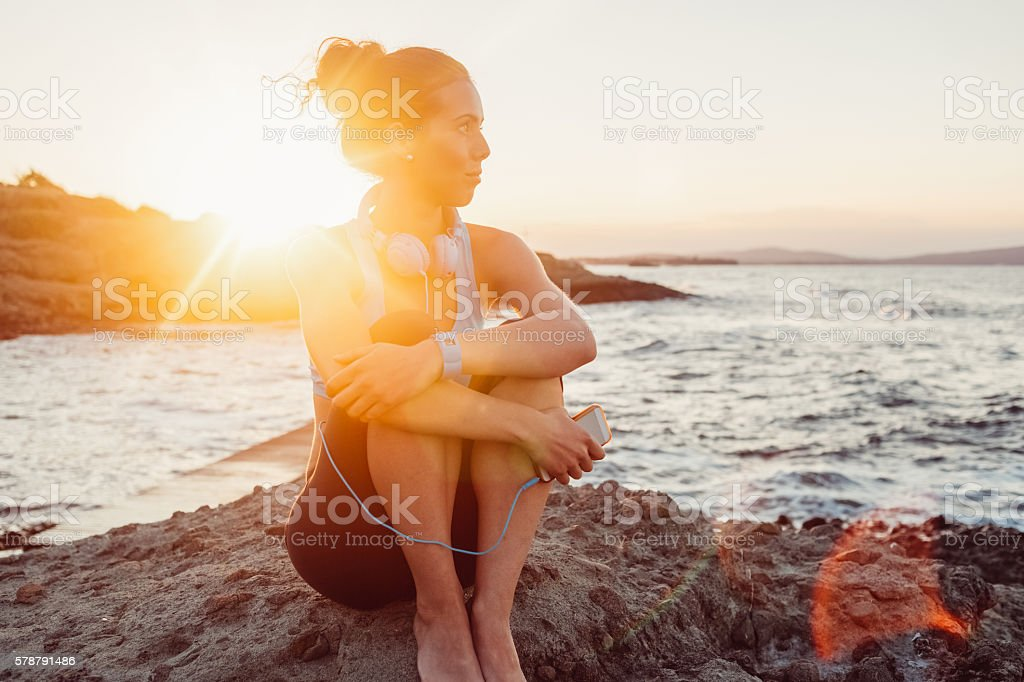 Sportswoman resting after workout stock photo