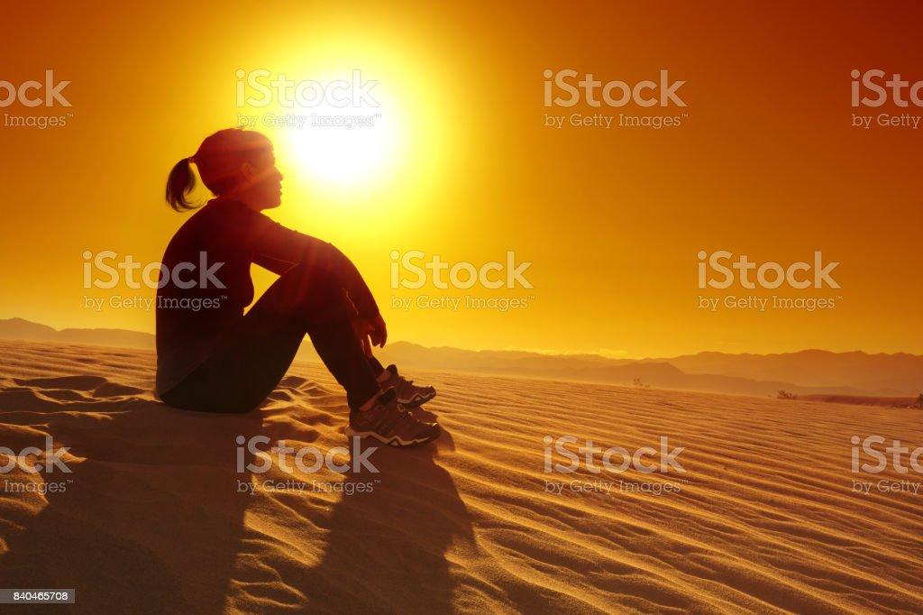 sportswoman resting on sand stock photo
