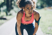 Young african-american woman resting after work out outdoors