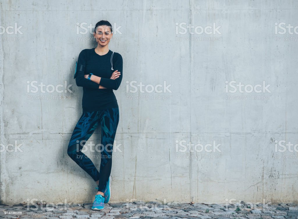 Sportswoman resting stock photo