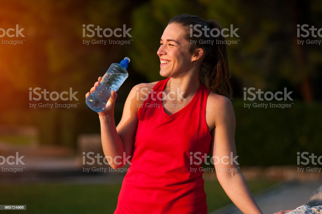 Sportswoman Resting with Water During Workout - Royalty-free Adult Stock Photo