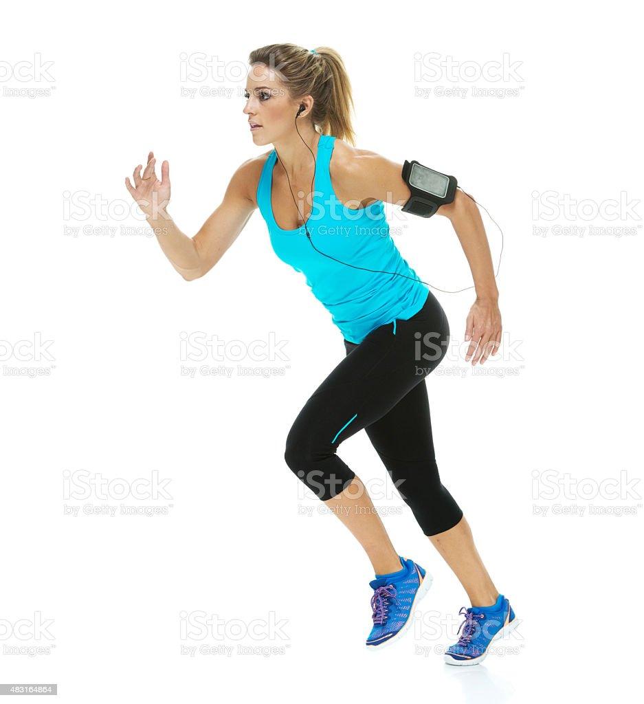 Sportswoman running stock photo