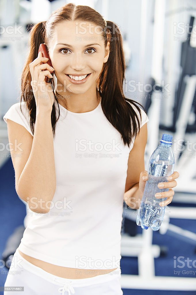 Sportswoman speaks on phone royalty-free stock photo