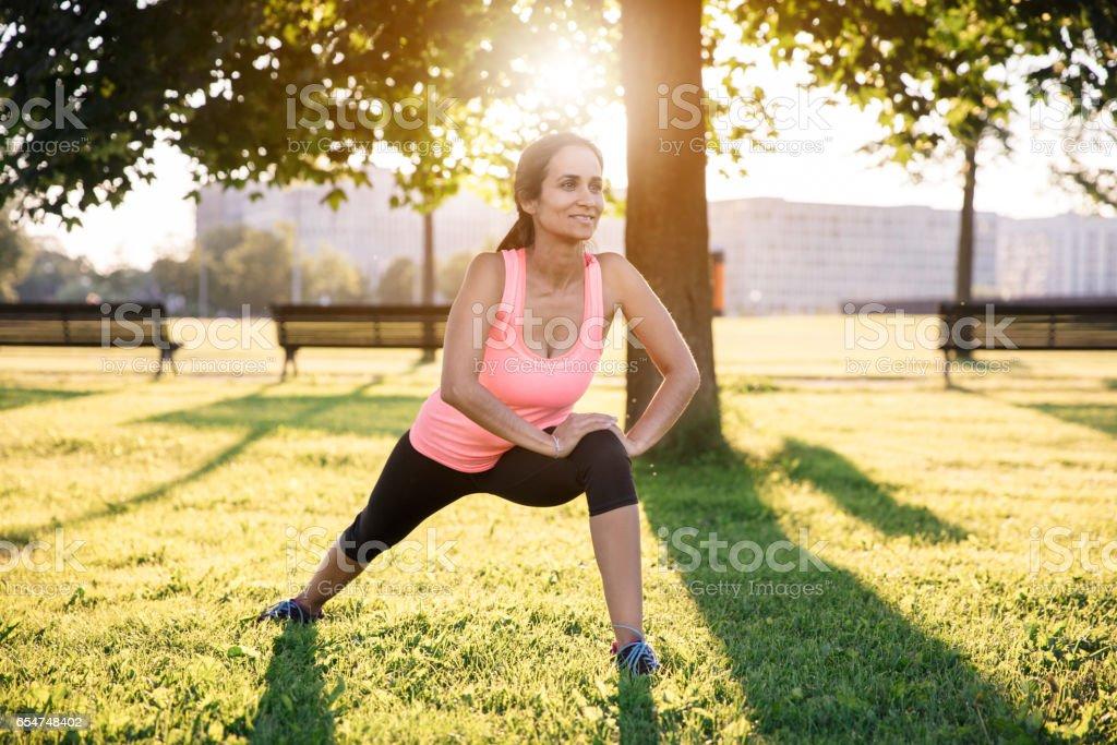 sportswoman stretching before the run stock photo