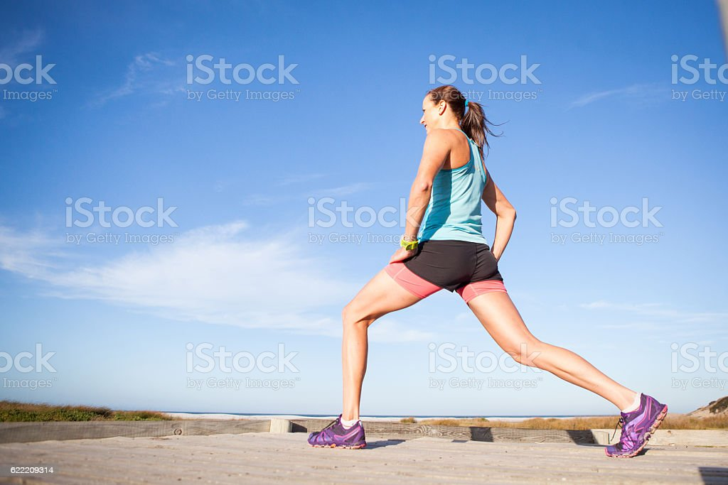 Sportswoman stretching stock photo