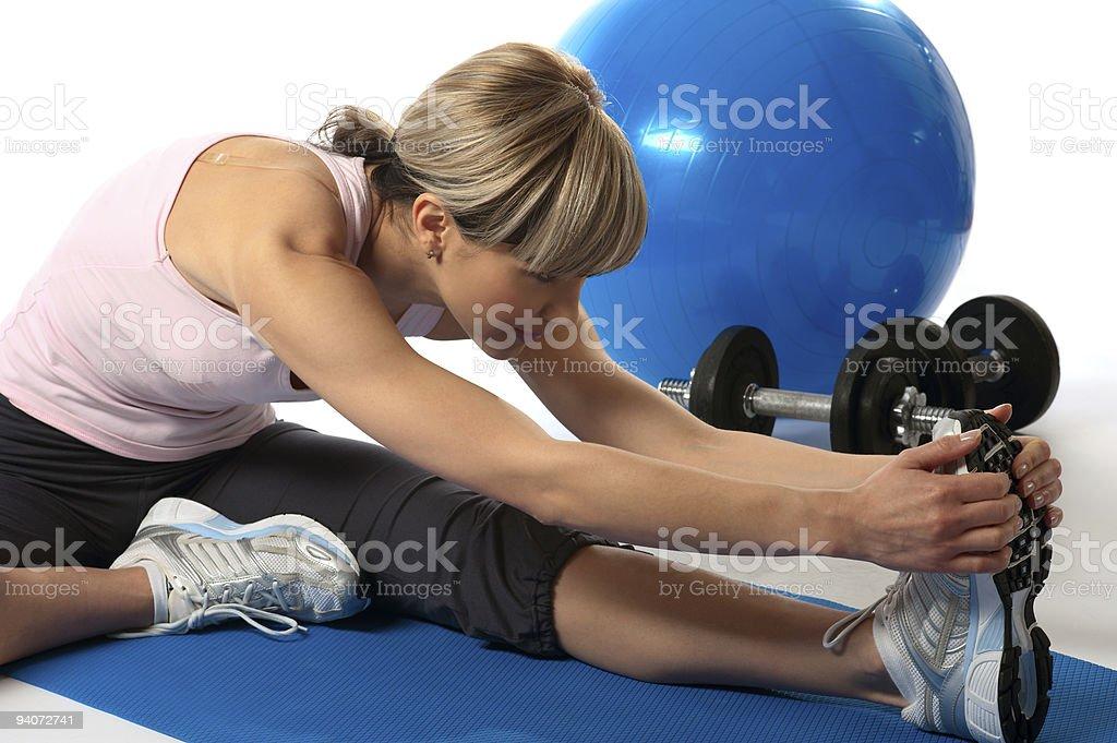 Sportswoman stretching royalty-free stock photo