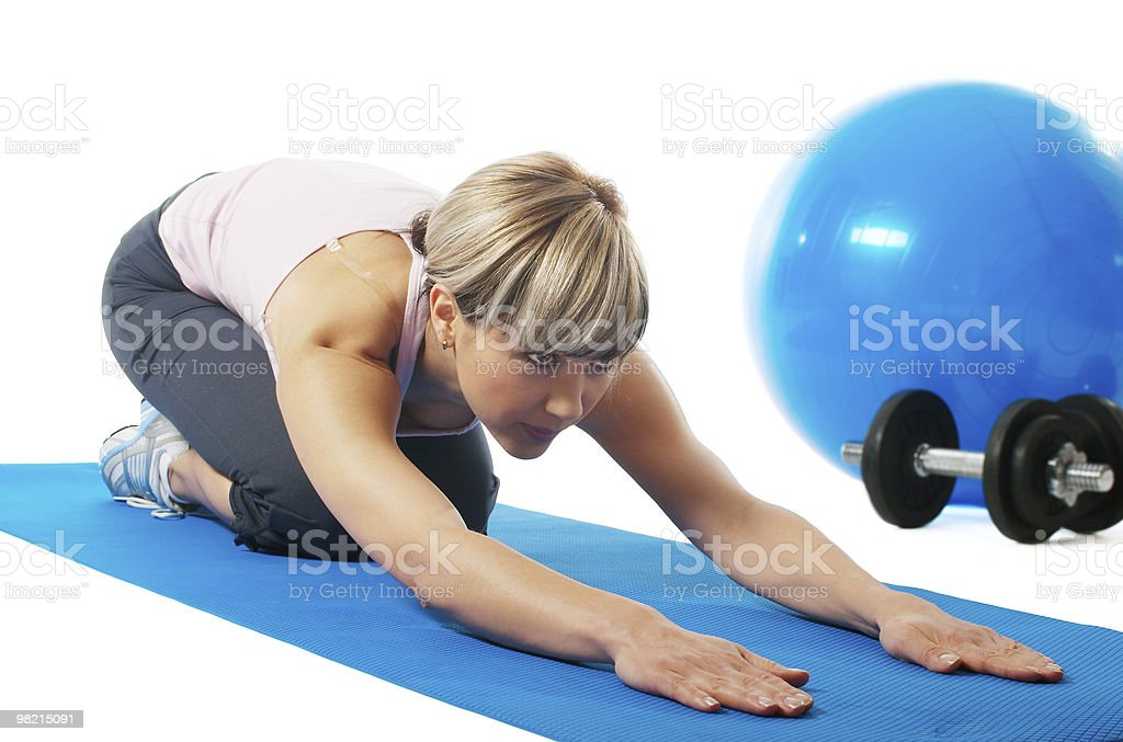 Sportswoman stretching royalty-free stock photo