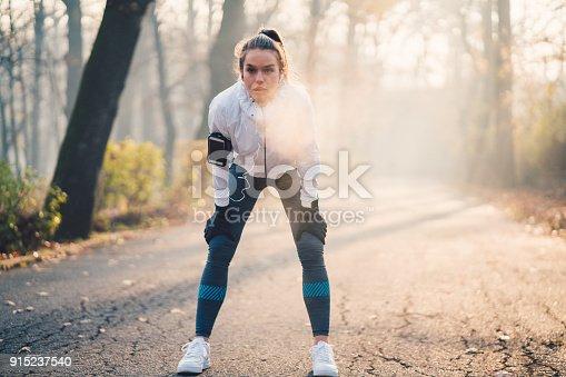 istock Sportswoman taking a breath 915237540
