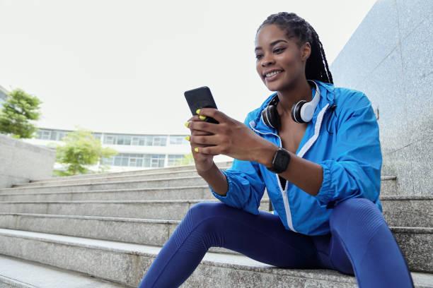 Sportswoman texting stock photo
