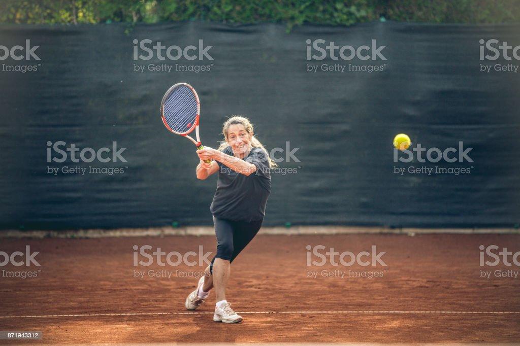 Sportswoman Training Tennis On Clay Court stock photo